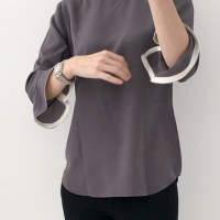 A grey silk blouse